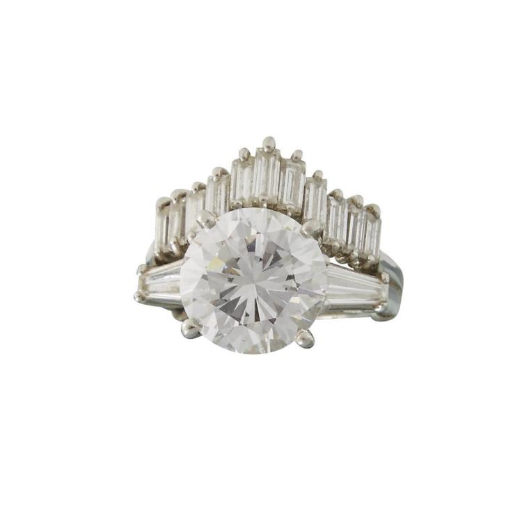 A diamond and platinum ring with guard,