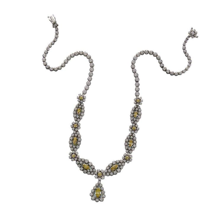 A diamond, colored diamond and eighteen karat white gold necklace,