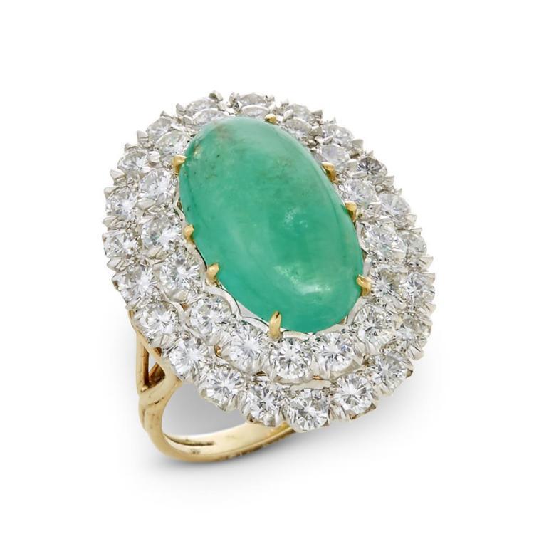 An emerald, diamond and fourteen karat gold ring,