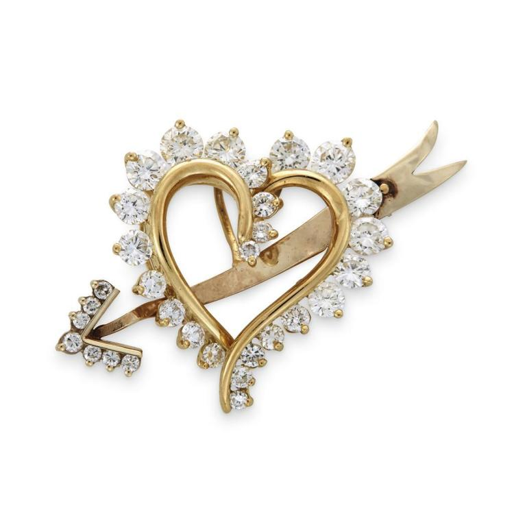 A diamond and fourteen karat gold pendant-brooch,