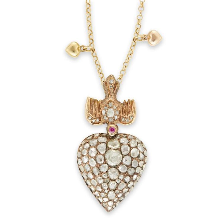 A diamond, synthetic ruby and fourteen karat gold pendant,
