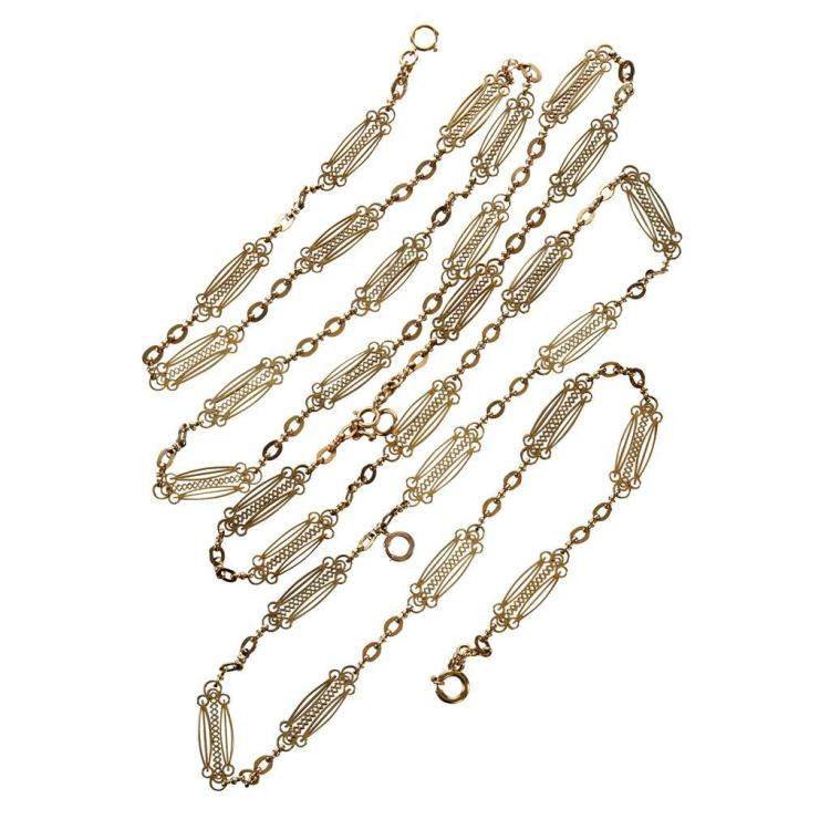 An antique fifteen karat gold long chain, circa 1810