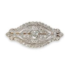 An Art Deco diamond and platinum-topped gold brooch, circa 1920