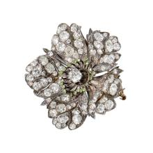 An antique diamond, demantoid and silver-topped gold brooch, circa 1890