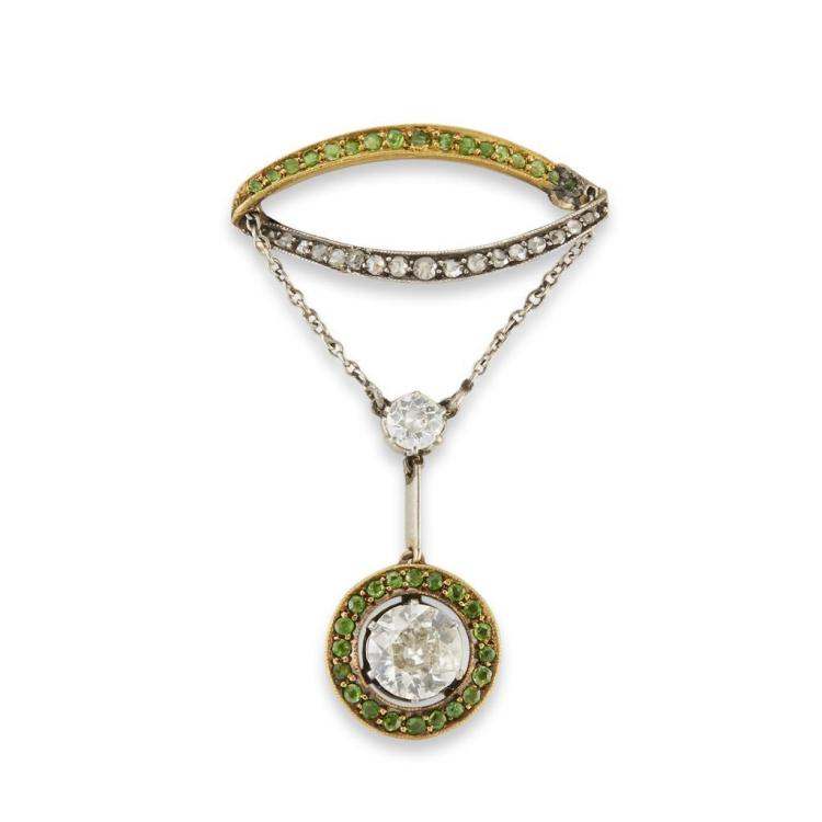 A diamond and demantoid garnet pendant-brooch,