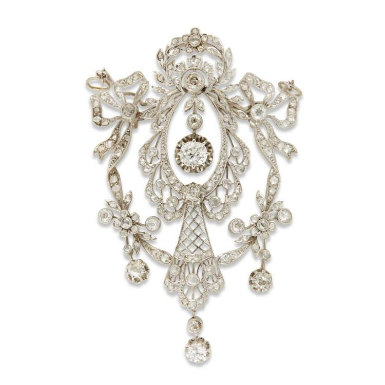 A diamond and platinum pendant brooch,