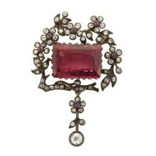 An antique pink tourmaline, diamond and silver-top fourteen karat gold pendant, circa 1900