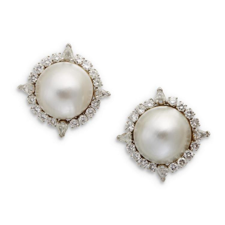 A pair of mabé pearl, diamond and fourteen karat white gold earrings,