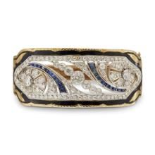 A diamond and platinum yellow gold bangle,