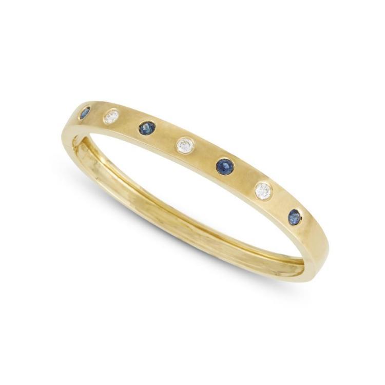 A diamond, sapphire and eighteen karat gold bangle, Craig Drake,