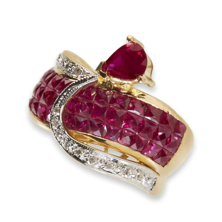 A ruby and eighteen karat gold ring,