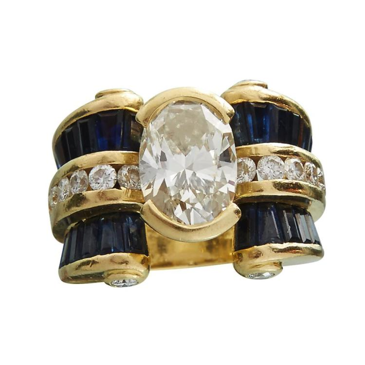 A diamond, sapphire and eighteen karat gold ring,