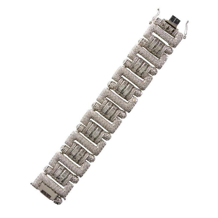 A diamond and eighteen karat white gold strap bracelet,