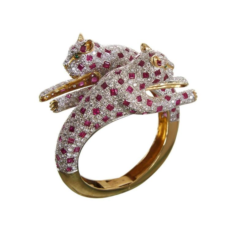A ruby and diamond panther bypass bangle,