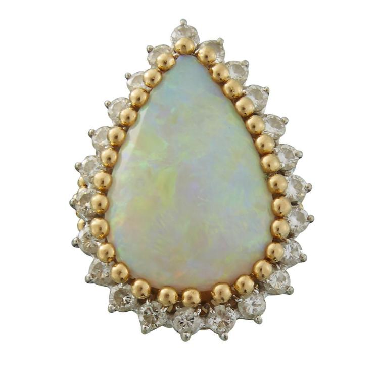 An opal, diamond and eighteen karat gold ring,