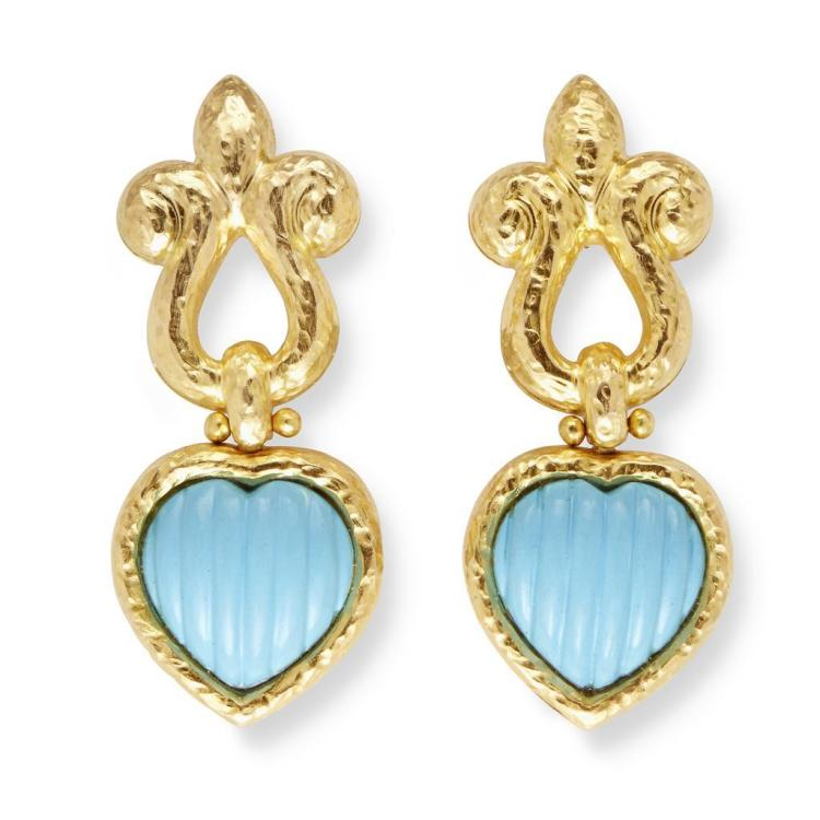 A pair of turquoise and eighteen karat gold earrings,