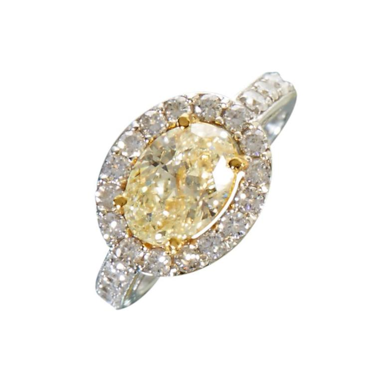 A colored diamond, diamond and eighteen karat white gold ring,