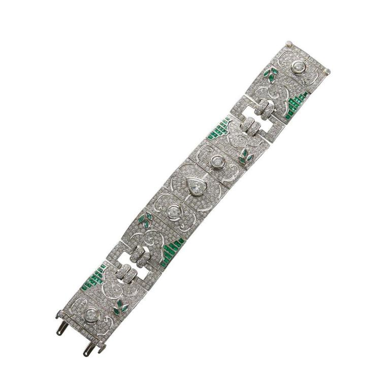 A diamond, emerald and platinum strap bracelet,