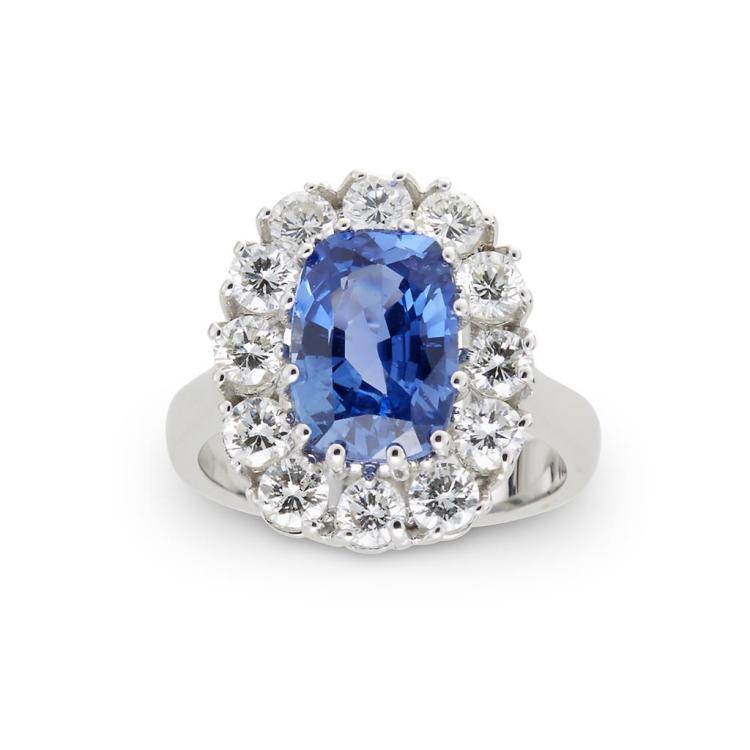 A sapphire, diamond and eighteen karat white gold ring,