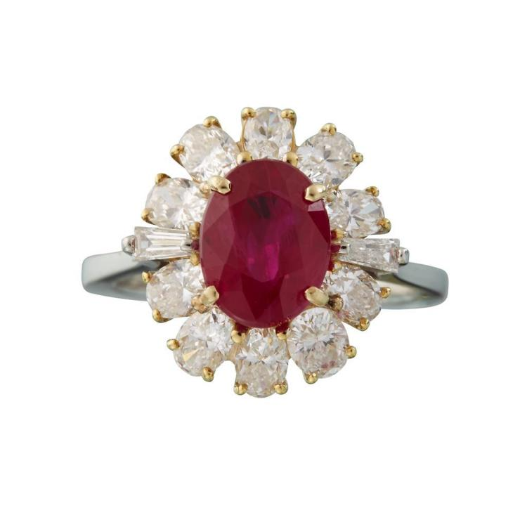 A Burma ruby, diamond, platinum and eighteen karat gold ring,
