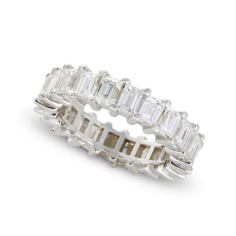 A diamond and eighteen karat white gold eternity band,