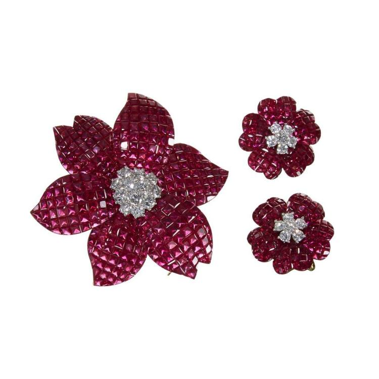 A ruby, diamond, platinum and eighteen karat gold brooch and earrings,