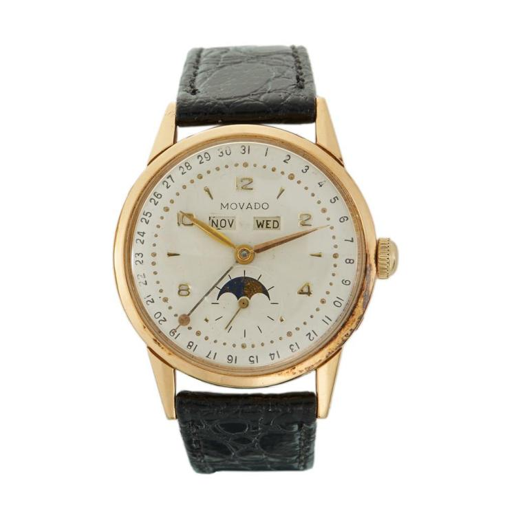 An eighteen karat gold triple calendar strap wristwatch with moon phase, Movado, circa 1950's