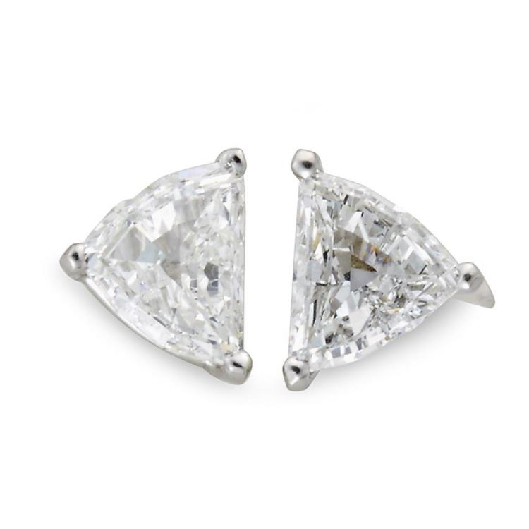 A pair of diamond and platinum stud earrings,