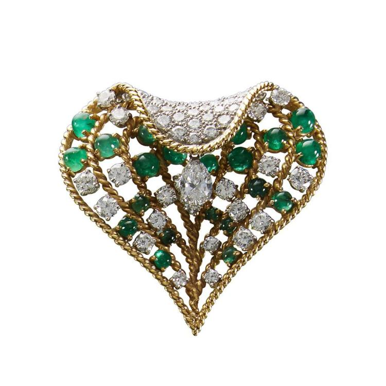 A diamond, emerald and eighteen karat brooch,