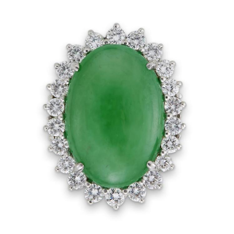 A jadeite, diamond, platinum and fourteen karat white gold ring,