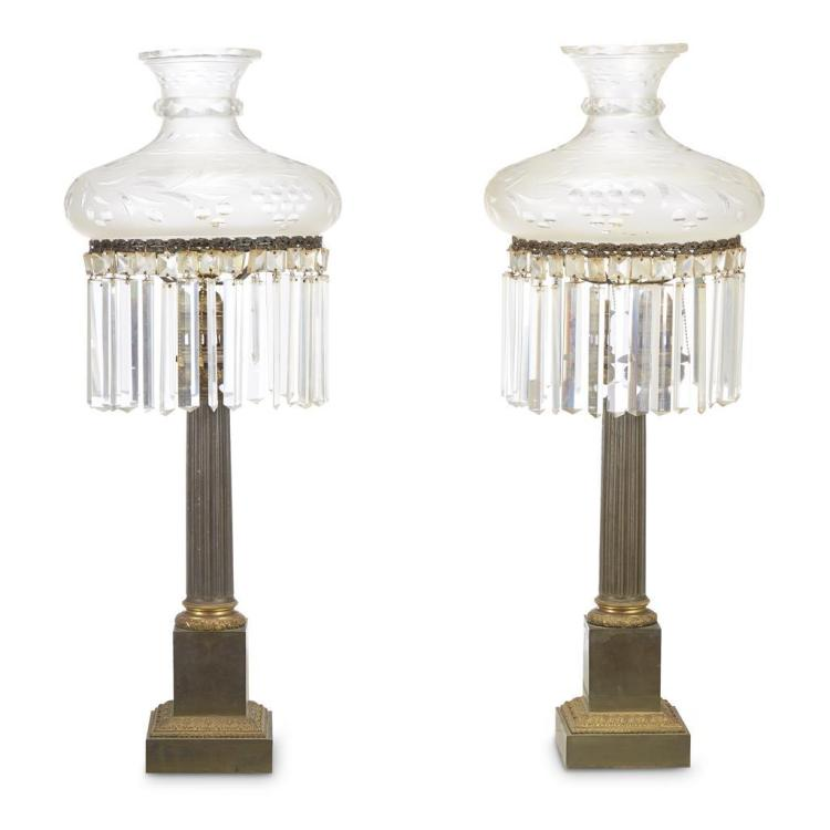A pair of American patinated and gilt-bronze Sinumbra lamps, 19th century