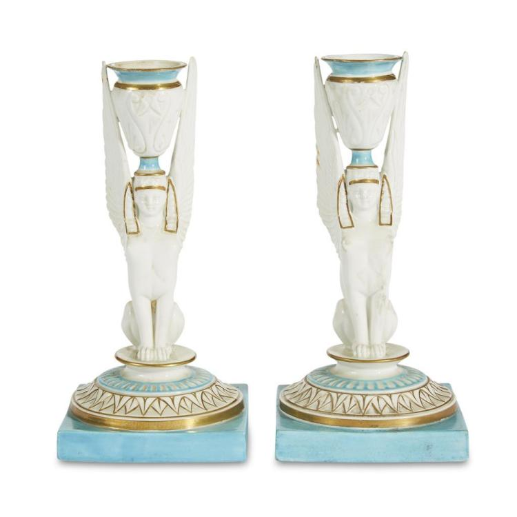 A pair of Continental porcelain candlesticks, apparently unmarked, 19th century