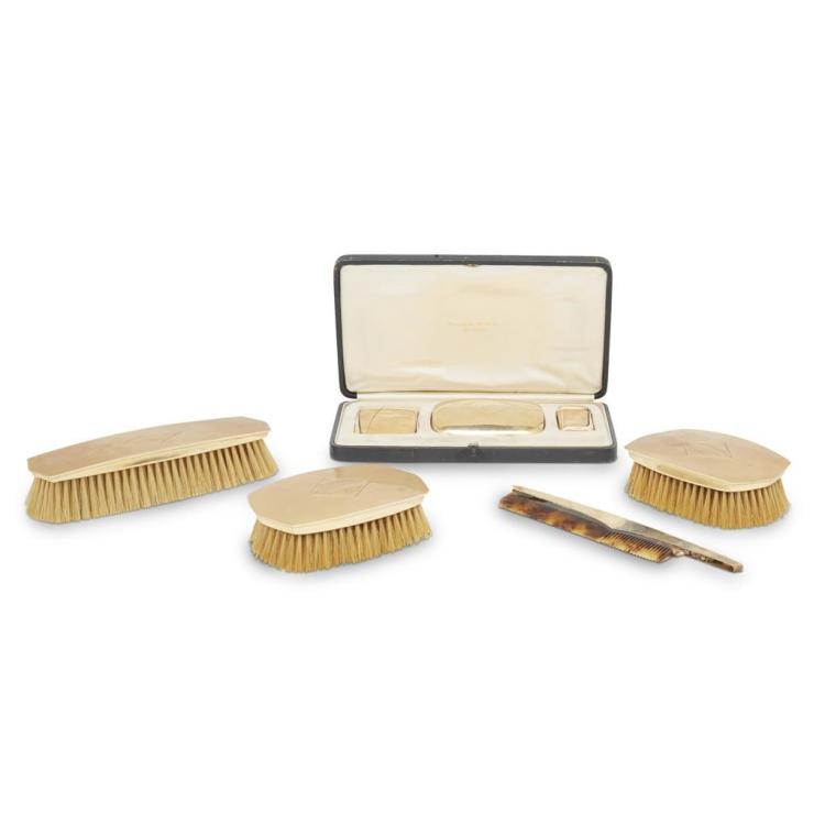 A seven piece gentlemen's 14k gold dressing set, retailed by Hennington, Bates Co., Baltimore, early 20th century