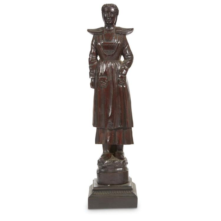 A carved wood figure of a Brittany woman, 19th century