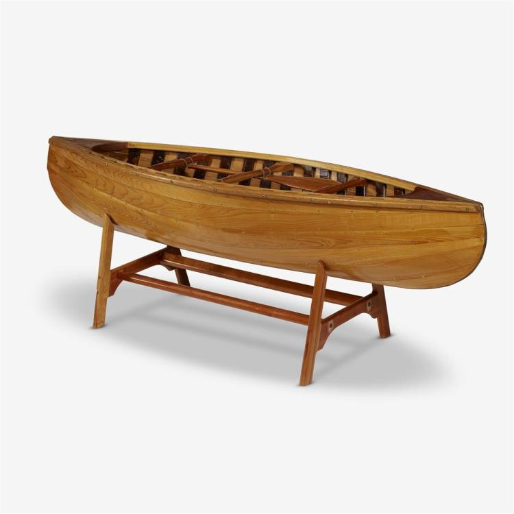 A coffee table in the form of a carved wood canoe on stand, 20th century