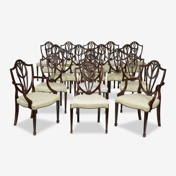 A set of eighteen Sheraton style shield and feather back mahogany dining chairs, 20th century