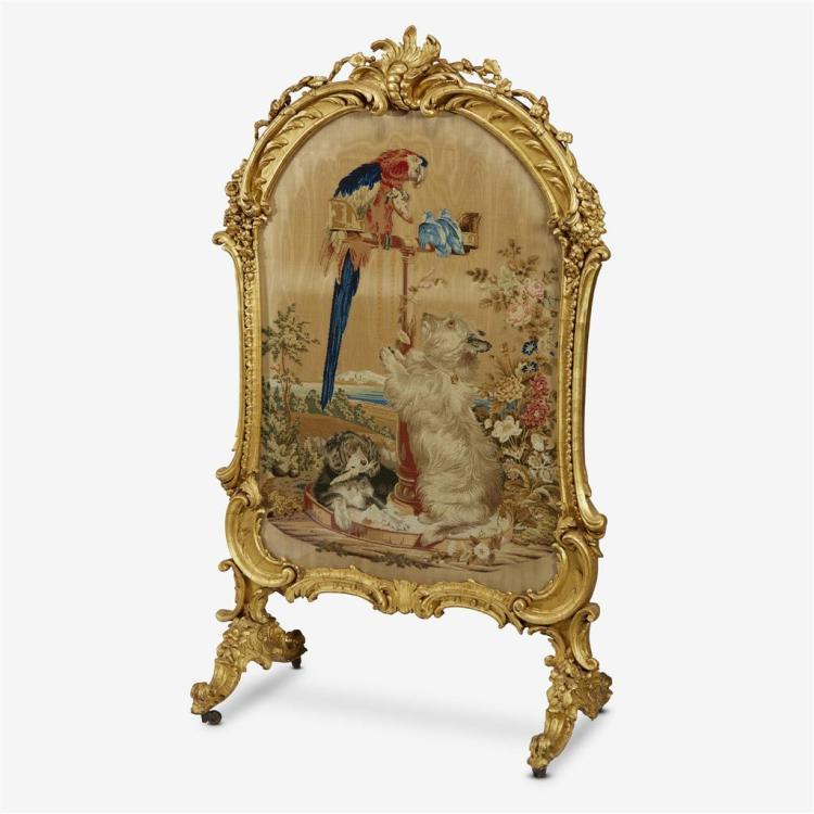 A French Louis XV style giltwood firescreen with a Berlin woolwork panel depicting Queen Victoria''s Pets, Mid 19th century