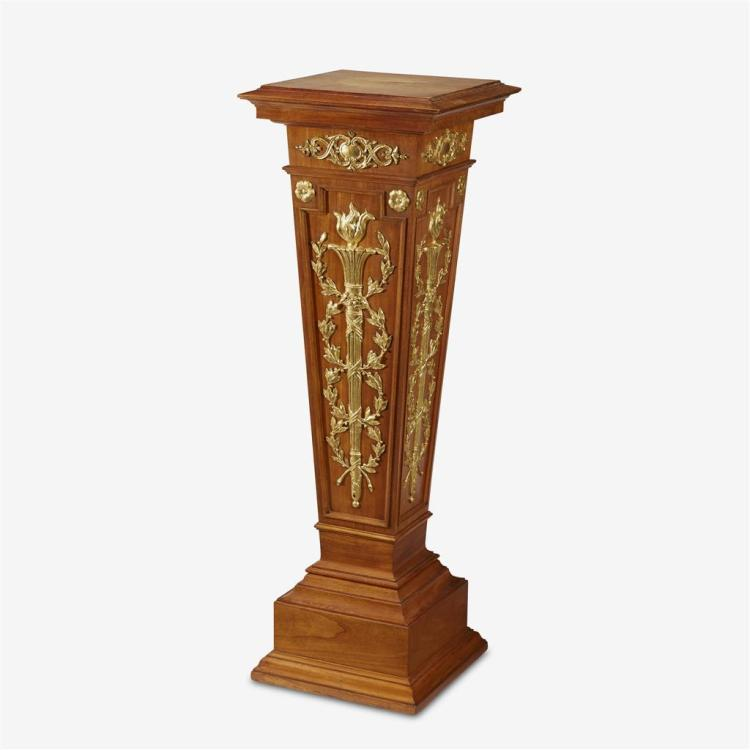 An Edwardian George III style parcel-gilt mahogany pedestal, First quarter 20th century