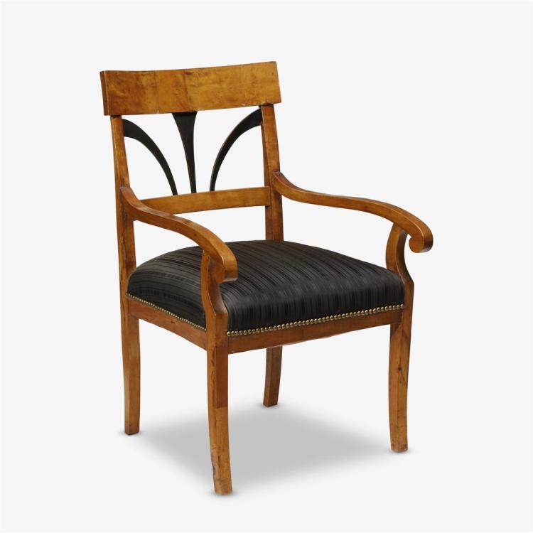 A Biedermeier parcel-ebonized birch armchair, First quarter 19th century