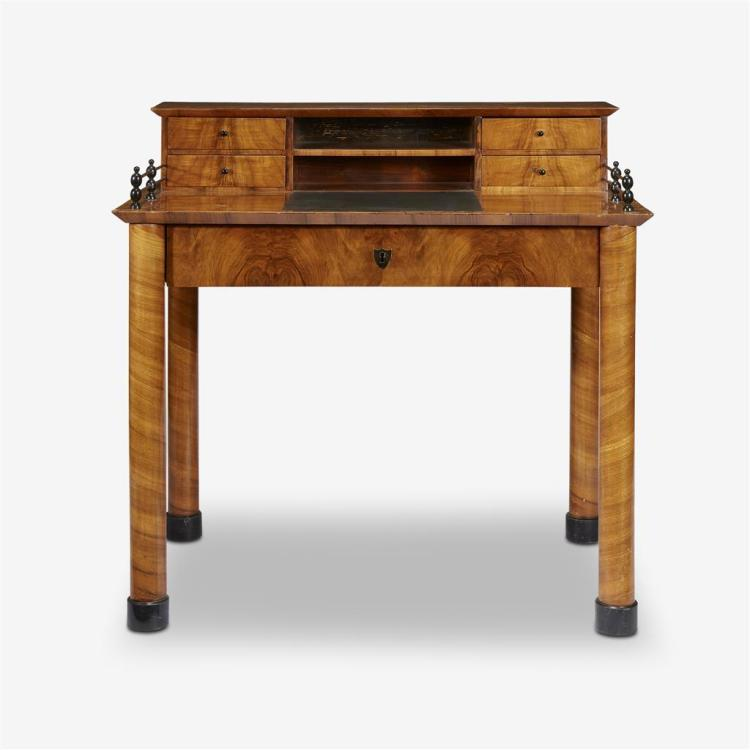 A Biedermeier parcel-ebonized cherrywood desk, Attributed to Josef Danhauser, circa 1820