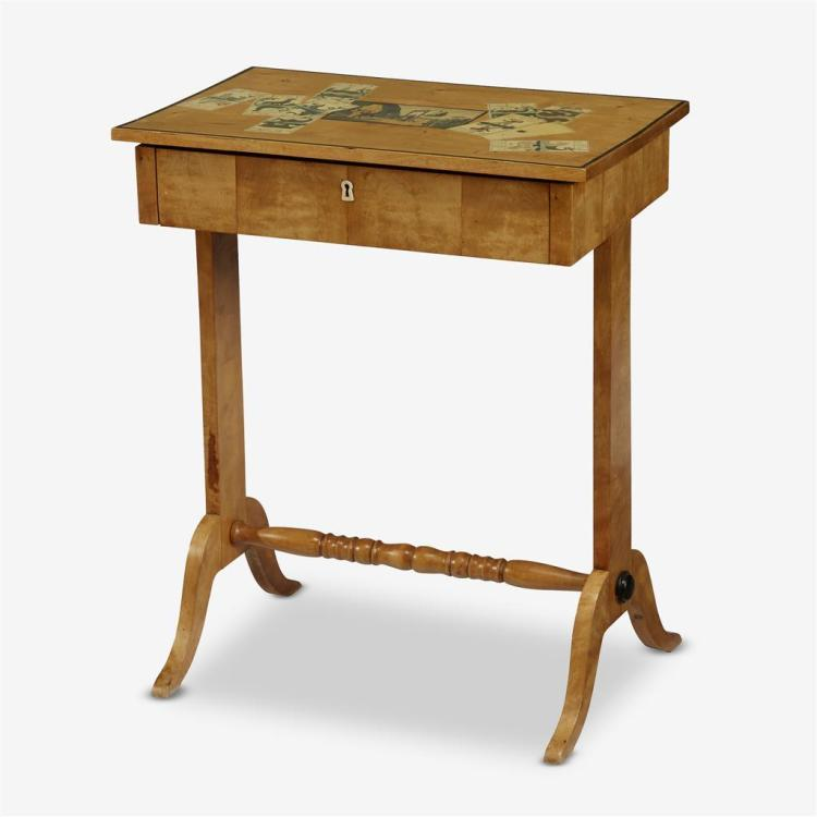 A pale birch and ebonized work table with decoupage, Circa 1840