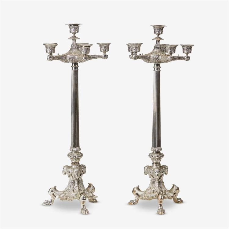 A pair of French Neoclassical silvered bronze candlesticks, After the model by Barbedienne, late 19th century