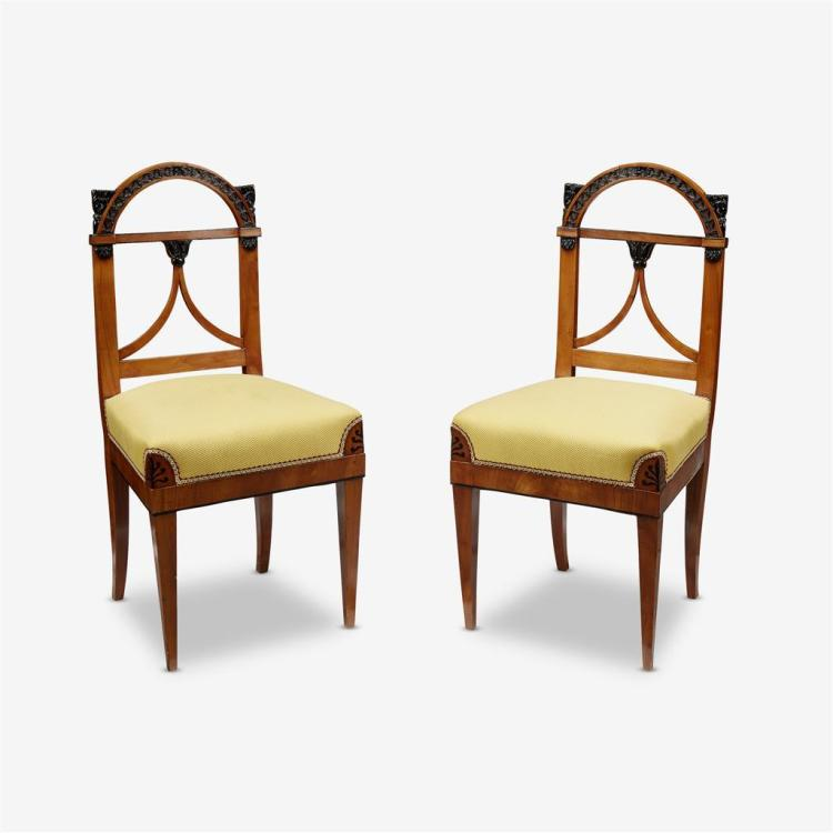 A pair of German neoclassical parcel-ebonized cherrywood side chairs, First quarter 19th century