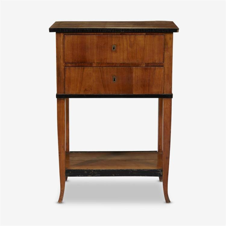 A Biedermeier parcel-ebonized cherrywood two-drawer side table, Circa 1825