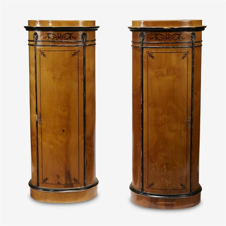 A pair of German neoclassical parcel-ebonized maple cabinets, North German, circa 1815