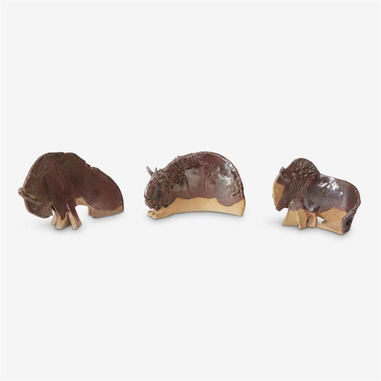 Three abstract glazed stoneware bison, 20th century