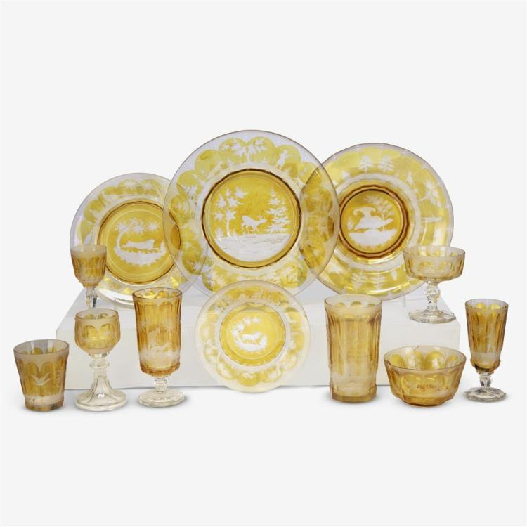 A Bohemian amber-flashed cut-glass part dinner service decorated with hunt scenes, 20th century