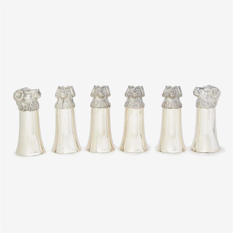 Six silver-plated ram''s head stirrup cups, Circa 1900