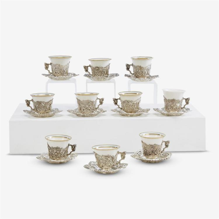 Ten sterling silver pierced and repoussed demitasse cups and saucers, The Mauser Manufacturing Co., New York, NY, circa 1900