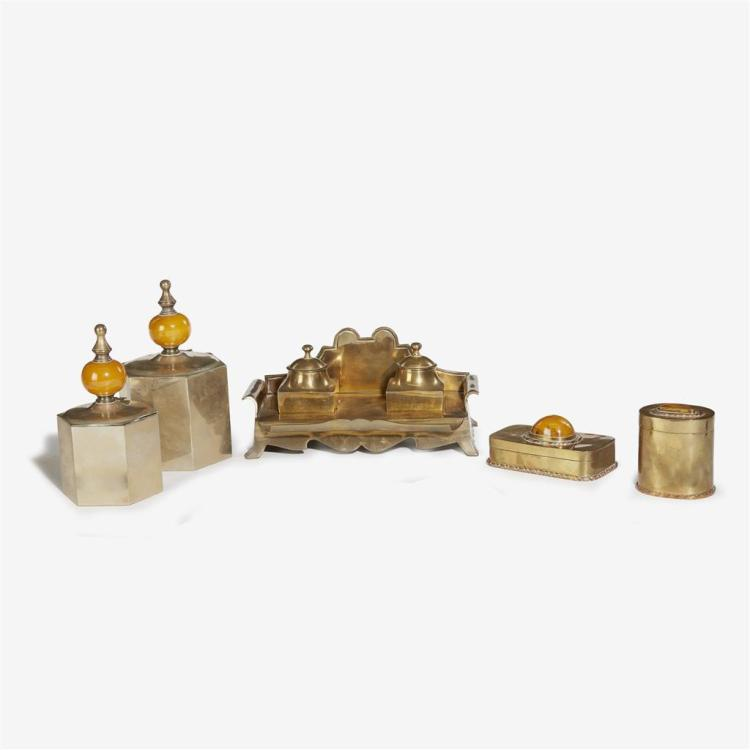 A Moroccan brass and amber desk set and two wine coasters, 20th century